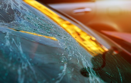 broken glass on of car with broken after crash accident windshield