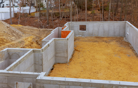 Under construction foundation new home with cement basement foundation