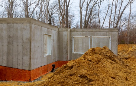 The construction site of a new home poured foundation of concrete construction works Stock Photo