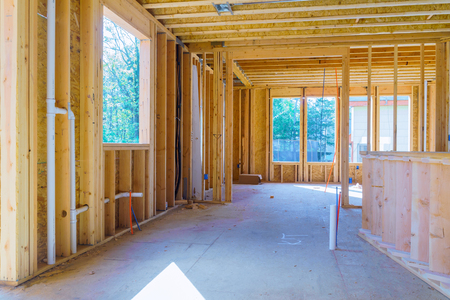 Timber frame house, real estate. stick built home under construction build with wooden truss, post and beam framework.