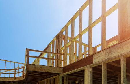 House framing construction framing beam against a blue sky