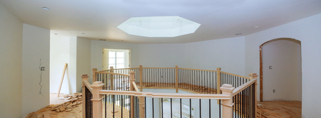 Home new construction staining with stains staircase with wood railings