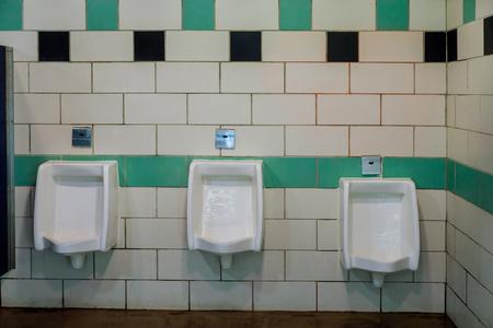 Close up white urinals men public toilet in ceramic urinals for men in toilet room.