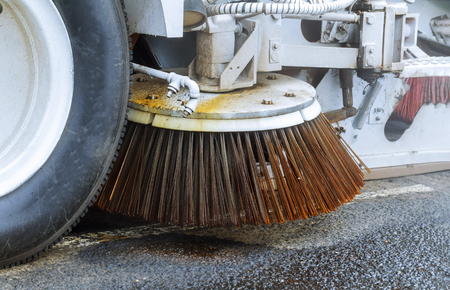 Machine car cleaning the road detail of a street sweeper in the process of cleaning the street