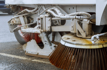 Part of a street cleaning vehicle car cleaning the road