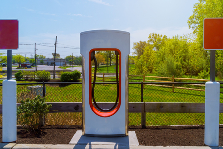 Electric charged by a supercharger charging station in the parking lot