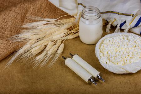 Symbols of jewish holiday shavuot kosher food torah wheat Stock Photo