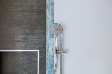 Close up of shower head cubicle in the modern bathroom