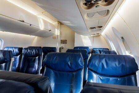Airplane inside interior passenger airliner of the aircraft during the flight of tourists flying