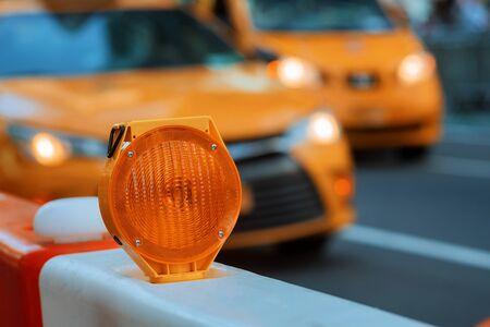 Orange traffic barrier barrels to detour traffic around construction zone shallow depth of field Stock Photo