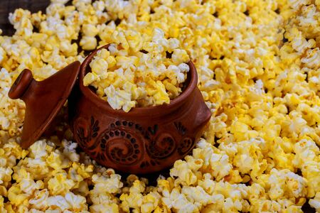 Bowl with popcorn on wooden table Popcorn homemade in Brown