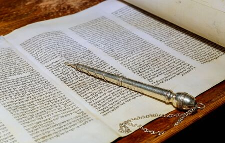 NEW YORK NY March 2019. The Hebrew Torah old scroll book on a synagogue Jewish holidays, during letters of scriptures close up.