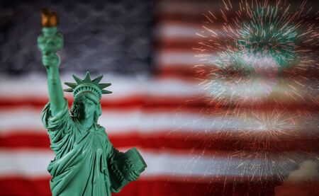 flag of the United States of America with statue of liberty colorful fireworks