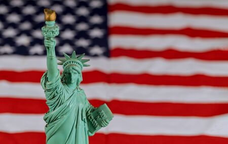 The Statue of Liberty the United States a symbol of freedom and democracy with flag of the United States of America Stockfoto