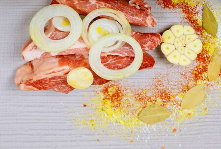 Raw pork steak on a white wooden table and spice Stok Fotoğraf