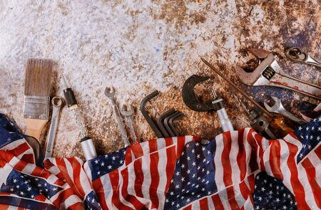 Wrench constructor tools on a United States of America flag in Labor Day is a federal holiday with many handy tools Stock Photo