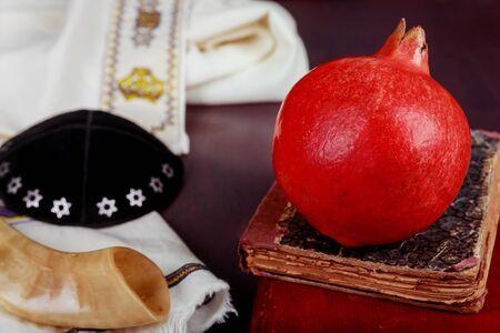Jewish New Year Rosh Hashana traditional food of torah book, kippah a yamolka talit