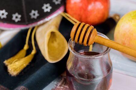 Honey and apples on shofar horn jewish holiday Rosh Hashanah torah book, kippah a yamolka talit