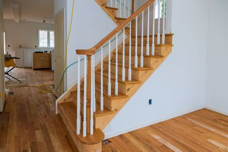 Wooden planks around pole stairs handrails renovation for railing for stairs