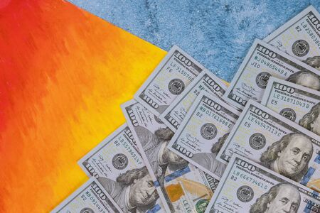 Hundred dollar banknotes, isolated on rainbow background. Finance concept. Stock fotó