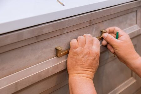 Hand on handle installation drawers in custom kitchen cabinets