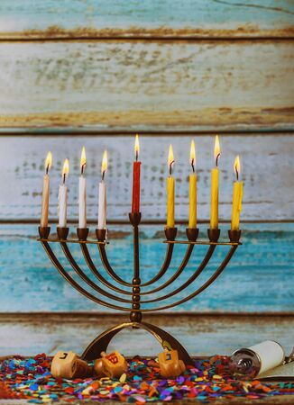 Colorful candles from a burning hanukkah candles in a menorah Фото со стока