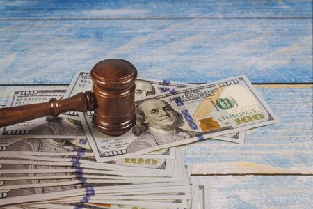Judge gavel and money on blue wooden table. Court concept. 写真素材