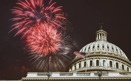 Independence Day Fireworks over Capitol Building at night in Washington, D.C july 4th