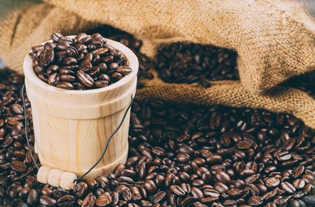 Coffee of roasted beans in a bucket on a roasted coffee beans background Reklamní fotografie
