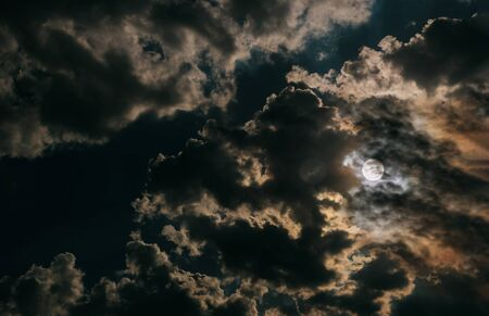 Full moon and white night clouds sky
