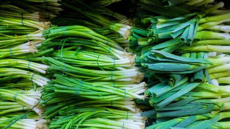 Green onion in the market counter organic fresh vegetables