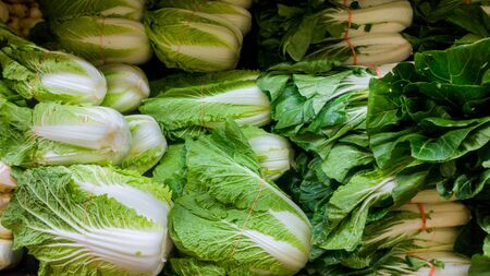 Fresh vegetables greens on counter on the grocery farmer market Stok Fotoğraf