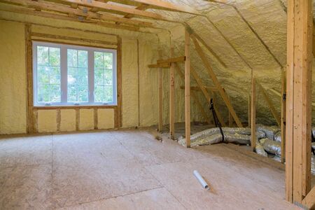 Insulation of attic with thermal insulation cold barrier and insulation material thermal insulation attic 写真素材 - 129460788