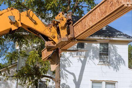 Forklift stacker loader construction showing joists trusses wooden frame house foundation