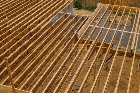 Engineered wood floor joist on a new custom house framing floor joists