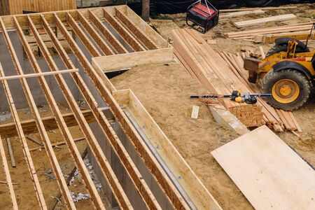 Construction showing massive solid wood joists construction forklift stacker loader Stock Photo