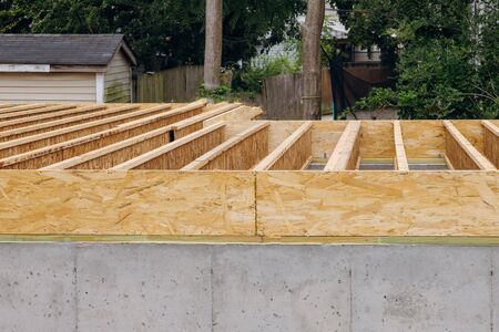 Installation if the construction frame house showing joists trusses