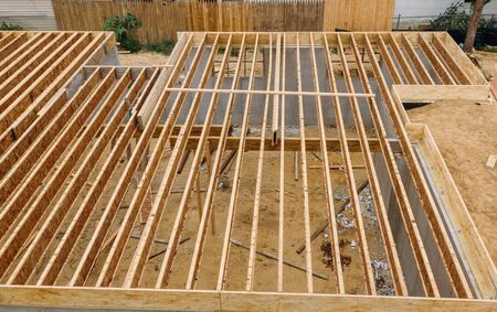 House framing floor construction showing massive solid wood joists trusses