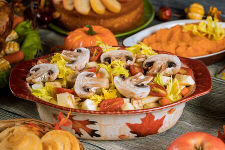 Thanksgiving dinner with mashed sweet potato, salad with mushrooms, pumpkin, apple. Stockfoto