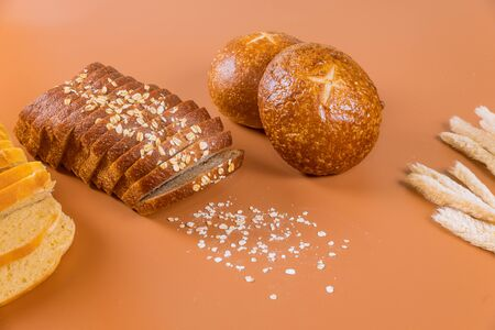 Different types of fresh bread with grain on table. Reklamní fotografie