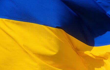 Fabric waving flag of Ukraine the national yellow and blue flag Standard-Bild - 130813455
