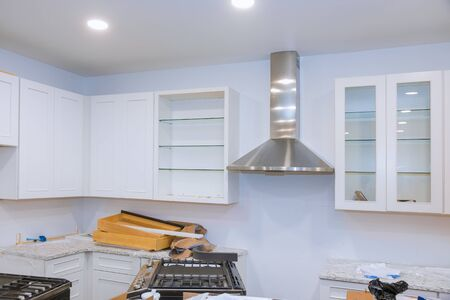 Preparing to install custom new kitchen cabinet in modern