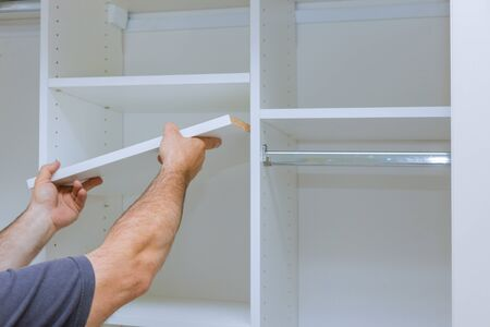 Assembling shelves for closet cabinet with home a new apartment wall installing a shelf