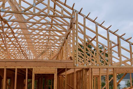 New house beam construction framing wooden house tiled roof Reklamní fotografie