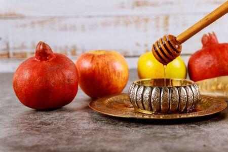 Apple and honey, traditional kosher food of jewish New Year Rosh Hashana shofar