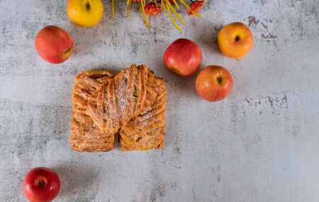 Homemade apple strudel with crispy apples on white table. Reklamní fotografie