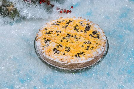 Berry pie with christmas decoration on artificial sparkle snow.