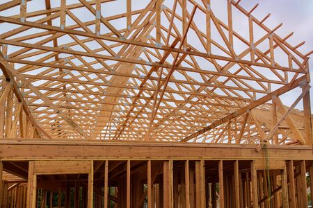 Wooden beam house roof residential construction home framing Reklamní fotografie