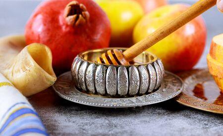 Apple and honey, traditional kosher food of jewish New Year Rosh Hashana talit and shofar