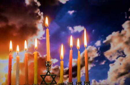 Hanukkah menorah with candles, twilight sunset sky background Banco de Imagens - 130814141